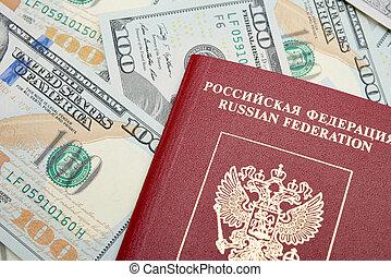 Russian passport with American dollars