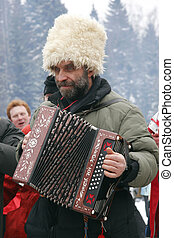 russian peasant playing accordeon - old bearded peasant in...