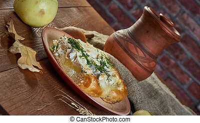 Siberian pie with fish and potatoes