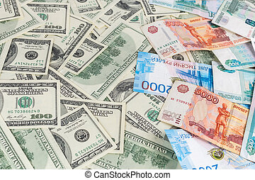 russian rubl and us dollar banknotes close-up with selective focus