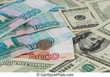 russian rubl and us dollar close-up background with selective focus