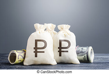 Russian ruble money bags and cash. Capital investment. ...