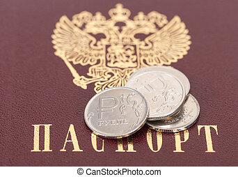 Russian rubles coins against the background of the Russian passport