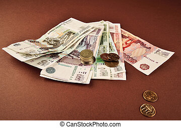 Russian rubles coins on brown background