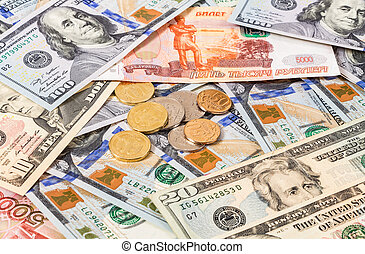 Russian rubles coins over dollars banknotes close up