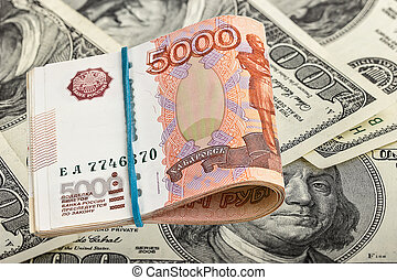 Russian rubles on dollars background
