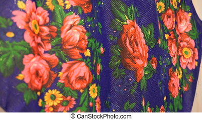 Russian scarf in the form of red roses. Close-up