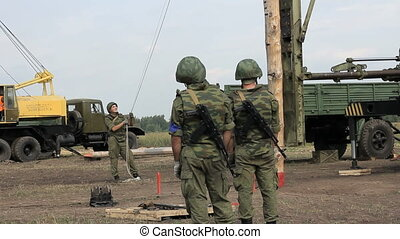 Russian Soldiers work with Pile Driver.