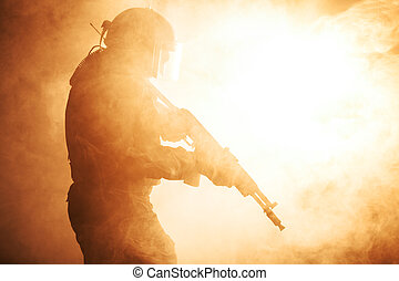 Russian special forces operator in bulletproof helmet in the smoke and fire
