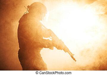 Russian special forces operator in bulletproof helmet in the...