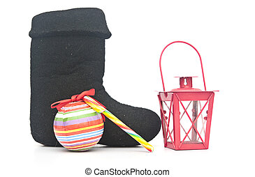 Russian traditional winter felt boot valenki and christmas decoration on the white