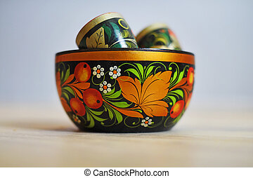 Russian traditional wooden Cup in the style of Khokhloma