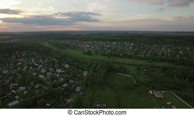 Russian village and moving cargo train, aerial view - Aerial...
