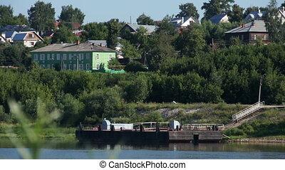 Russian village scenic view on riverside