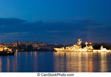 Russian warship in the evening bay.