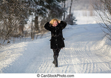 Russian woman in the winter at snowy street at village.