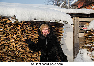 Russian woman in the winter at village.