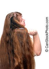 women combing her beautiful long red hair