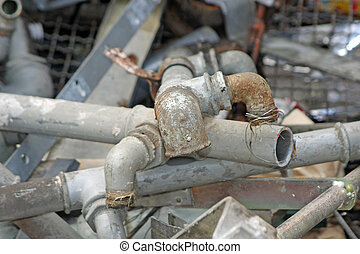 rusted and old iron pipes and lead into a junkyard of...