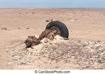 Rusted axle, differential and wheel of truck at Toscanini mine