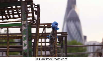Rusted bars with buildings - A left to right panning shot of...