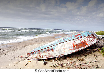 rusted boats on the sea beach sand