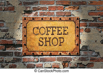 Coffee shop painted sign on heavily rusted metal plate, with rusted, riveted edges. That, on a very old brick wall.