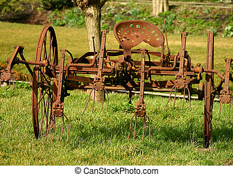 Rusted farm equipment - A piece of rusted old horse-drawn ...
