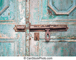 rusted keyhole on wooden door