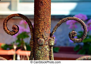 rusted metal fence with ornaments