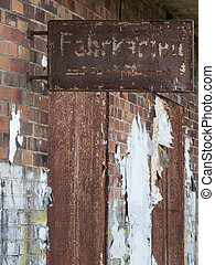 rusted sign on brick wall