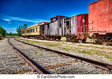 Rusted wagon trains - Old and rusted wagon trains over a...