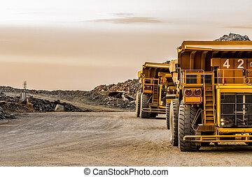 Dump Trucks transporting Platinum ore for processing