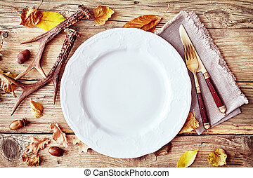 Rustic autumn or fall table setting with antlers