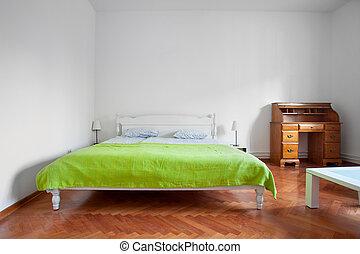 Rustic bedroom with parquet flooring.
