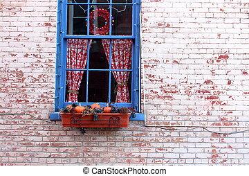 Rustic blue window in brick