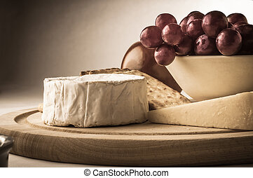 Rustic Cheeseboard with Grapes - Painterly photograph of a...