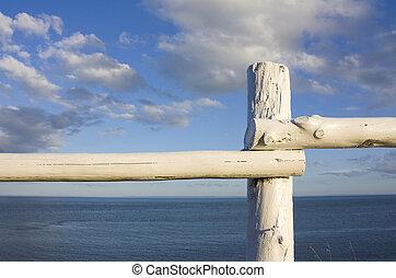 Rustic fence overlooking atlantic ocean shot in PEI, Canada