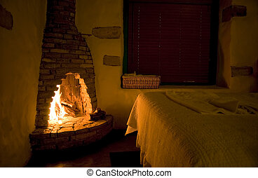 Rustic Fireside - Warmth emanating into a small rustic...