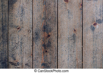 Rustic floor of non-painted planks closeup background -...