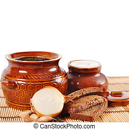 rustic food, soup in a clay pot on a white background