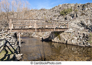 Rustic footbridge over Jarama River, La Hiruela, Madrid,...