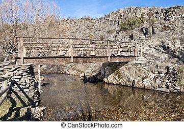 Rustic footbridge over Jarama River, La Hiruela, Madrid,...