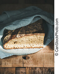 Rustic French rye bread loaf on wooden board