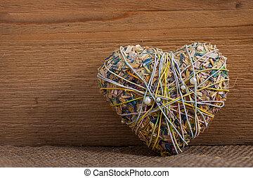 Rustic heart-shaped potpourri on wood