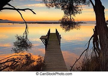 Rustic jetty sunrise