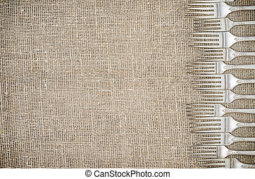 Rustic linen background with silver forks