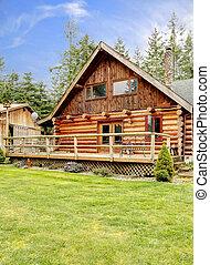Rustic log small cabin deck exterior.