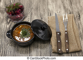 Rustic lunch of tomato soup with beef, beet salad on the ...