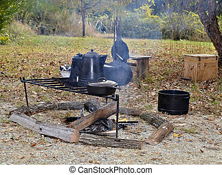 Rustic Outdoor Cooking - Cooking over an open campfire with...